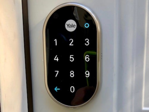 yale nest smart lock installed on a white door